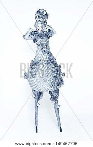 A woman dressed in luxury carnival costume silver light bulb