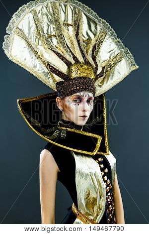 Close up portrait of Beautiful Golden Venetian Carnival Masked woman, sun costume