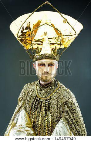 Beautiful Golden Venetian Carnival Masked man, sun costume