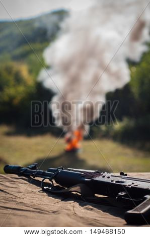 machine gun with fire and smoke - armed conflict solution