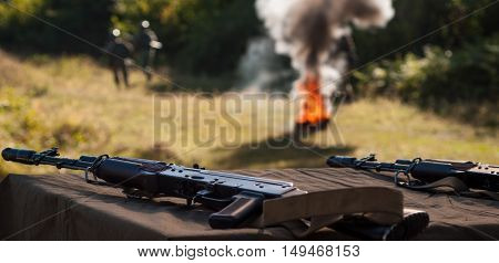 machine gun with fire smoke - armed conflict solution