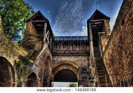 Medieval town gate in dramatic HDR with grunge atmosphere