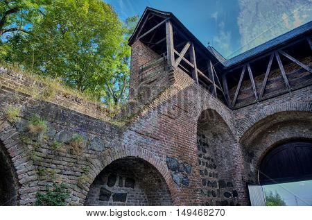 Medieval town gate in moderate HDR with vivid atmosphere