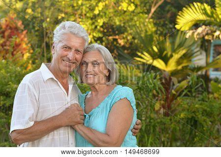 Senior couple have fun near  hotel resort