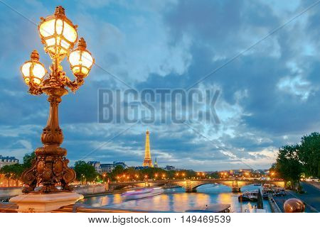 Paris. France - May 9 2014: City view from the bridge of Alexander III across the Seine at sunset. Paris is one of the most visited cities on the planet.