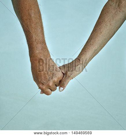 Hands held together on a blue background