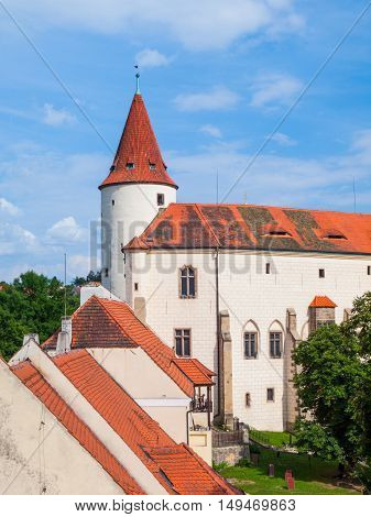 Courtyard, red rooftops and houses with white facade on Krivoklat Castle in Central Bohemia, Czech Republic