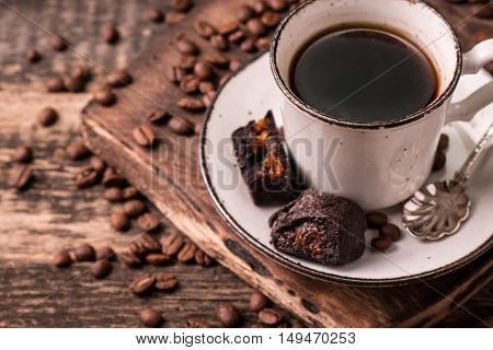 Coffee Cup With Roasted  Beans On Wooden Background