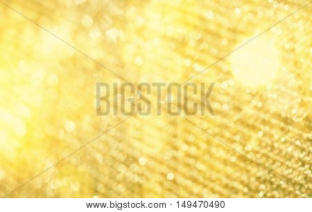 Abstract holiday background - golden bokeh and copy space