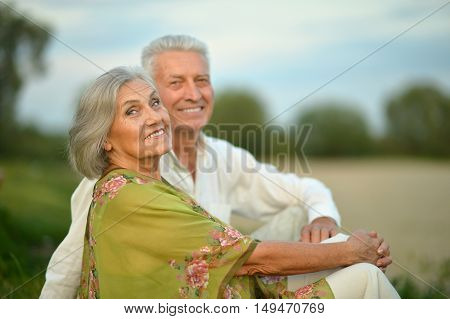 Portrait of a senior couple resting at summer park