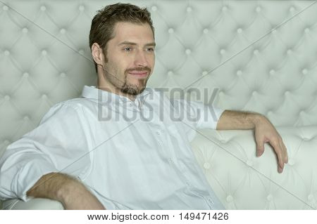 man in a casual style posing at home