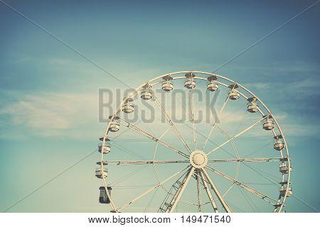 Retro Cross Processed Photo Of A Ferris Wheel.