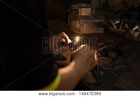 Mechanic or Electrician testing the light with multimeter meter