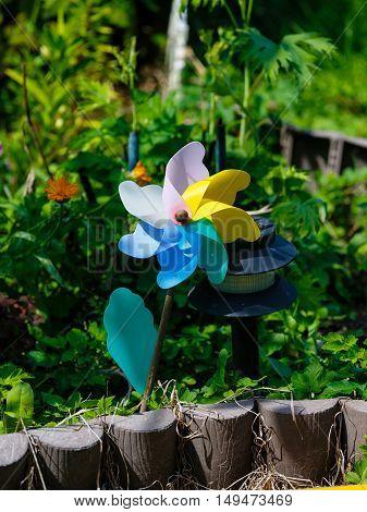 Windy revolving object in a flower garden