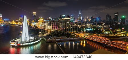 Shanghai China - October 23 2013: Aerial panorama at night of the Bund with Waibaidu bridge and Monument to the People's Heroes Shanghai China.
