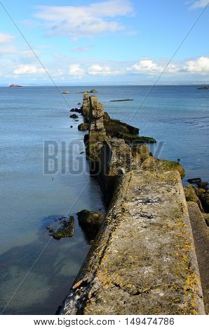 A view along the ruins of the old breakwater wall at seafield
