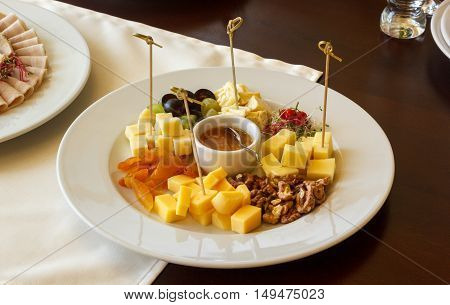 Cheese skewers with sauce on table at restaurant