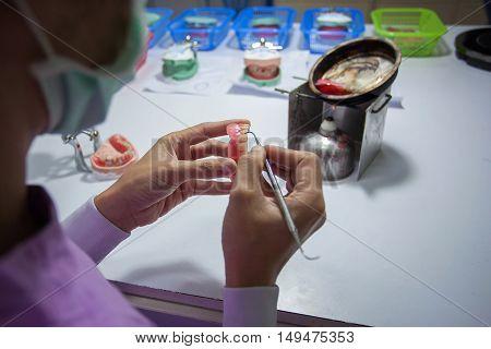 Dental laboratory manufacturing dental prostheses , medical