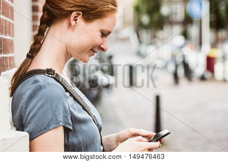 Woman With Phone In A City