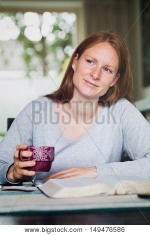 Woman With An Open Bible At Home