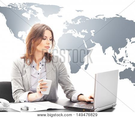 Beautiful business woman having a cup of coffee on world map background. Global business concept.