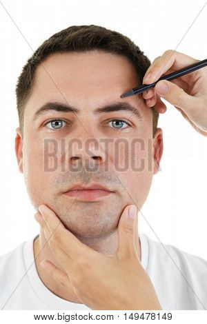 Plastic surgery concept. Hands marking male face