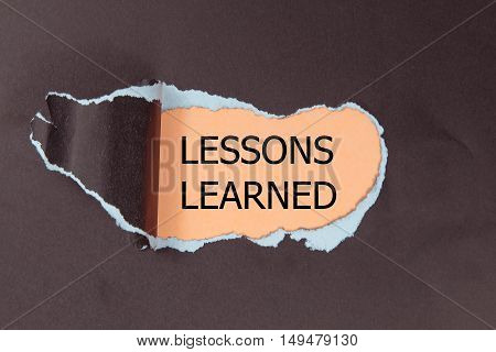 lessons learned written under torn black paper