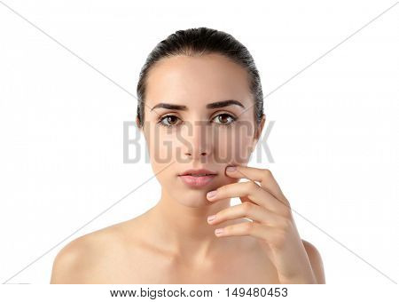 Beautiful young woman with natural makeup on white background