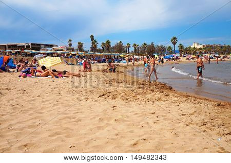 Frejus, France - Aug 16, 2016: Beach Scene With Holiday Makers On Vacation Enjoying Sand And Sea.