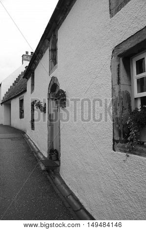 An exterior view of medieval buildings in a narrow street in Culross