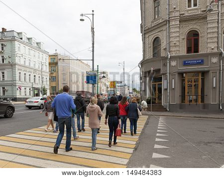 Moscow - September 10 2016: Pedestrian crossing on Mamontovskoye alley and people crossing the road September 10 2016 Moscow Russia