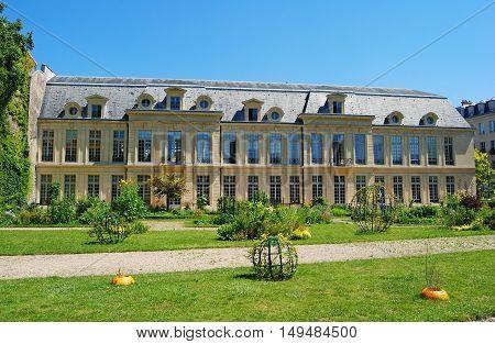 Paris, France - July 2, 2014. Hotel d'Aumont building in Paris, with grass lawn and vegetation.