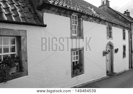 An external view of old residential buildings in the medieval village of Culross