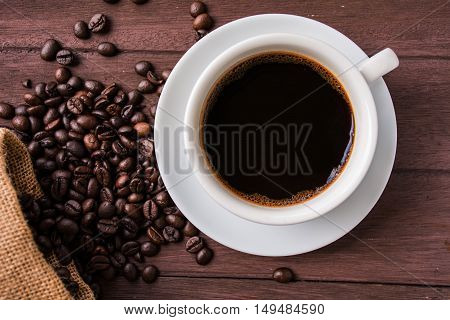 Top view /Coffee cup and coffee beans on table