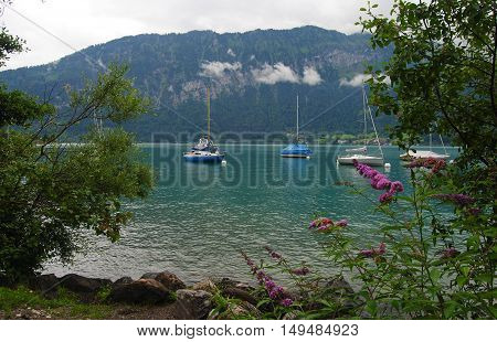 Lake Thun in Switzerland on a cloudy summer day