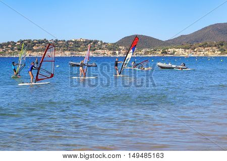 LA CROIX VALMER PROVENCE FRANCE - AUGUST 23 2016: People learning to windsurf at La Croix Valmer on the French Riviera