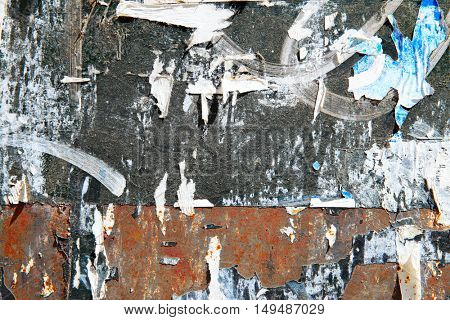 Torn posters on a wall