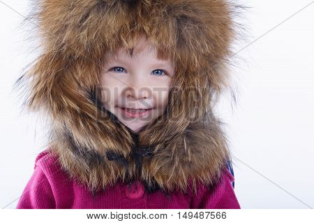 little funny girl with fur hat on white background