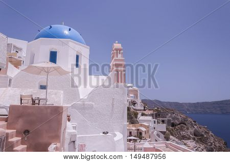 One of the famous blue domed churches from Oia on the greek isle of Santorini.