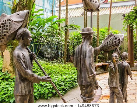 SINGAPORE, REPUBLIC OF SINGAPORE - JANUARY 09, 2014: Sculptures of Chinese processions in the Telok Ayer area, Singapore