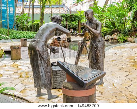 SINGAPORE, REPUBLIC OF SINGAPORE - JANUARY 09, 2014: Sculptures of Indian milk traders in the Telok Ayer area, Singapore