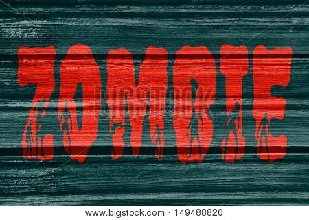 Zombie word and silhouettes on them. Halloween theme background. Wood texture