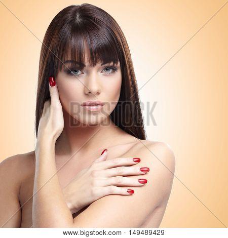 Portrait of beautiful female model on nude background
