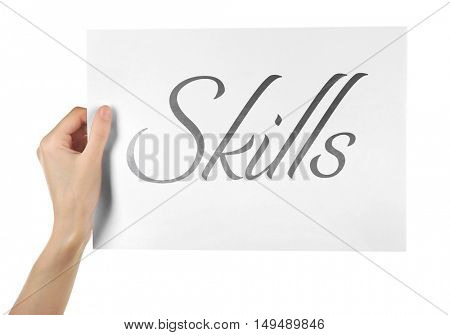 Skills.Female hand holding paper isolated on white