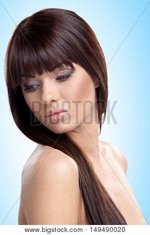 Portrait of beautiful female model on blue background
