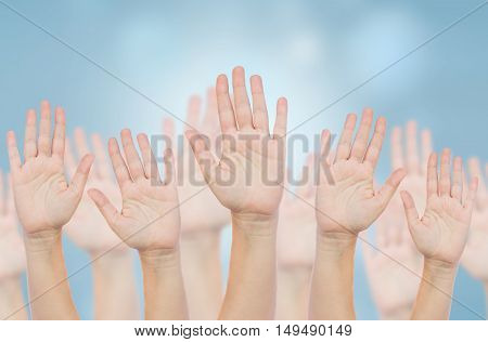 Hands up in the air - voting concept
