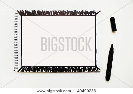Opened empty notebook page banner with black marker painted abstract frame isolated on white table background Copyspace for text advertising quote Planning concept idea simple action plan