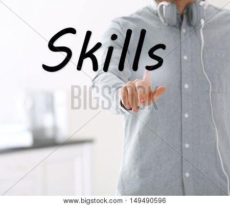 Skills. Young man push button on virtual screen