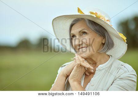 Portrait of a senior woman in summer park