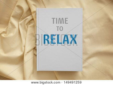 Text TIME TO RELAX on white book cover. Leisure concept.